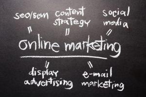 Handwriting on chalkboard of Online Marketing concept